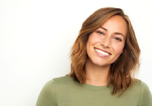 Smiling woman in a green shirt