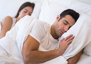 man sleeping soundly, without snoring