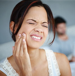 woman having severe dental pain