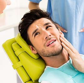 man suffering from toothache having a dental exam
