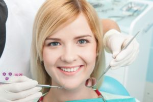 Smiling woman in dental chair.